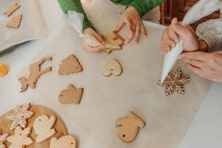 people decorating sugar cookies for Christmas
