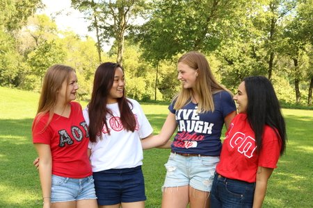 group of sorority sisters all wearing their greek letters