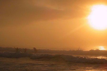 boogie boarders in ocean