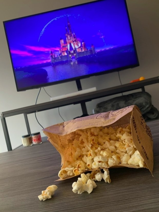 Popcorn and movie playing in the background
