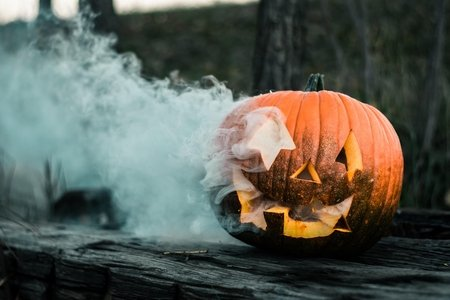pumpkin with white smoke billowing from it