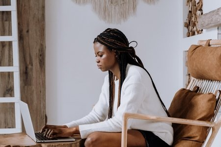 Woman sitting in chair looking at computer