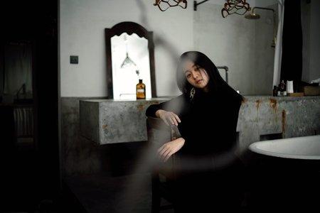 girl in all black sitting in aesthetic room