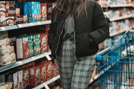 woman wearing puffer coat and plaid trousers bristol fashion