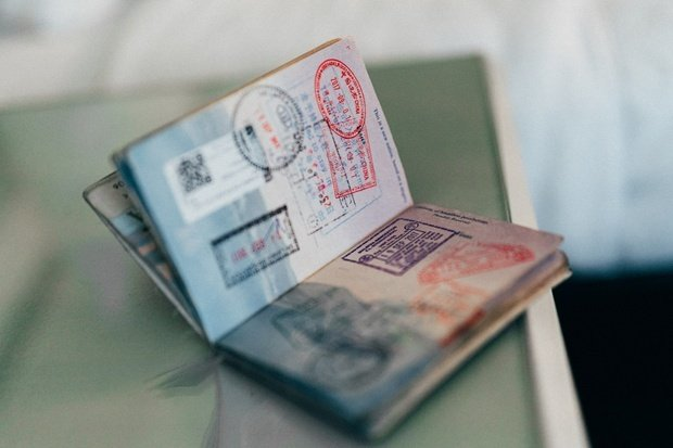 united states open passport with stamps