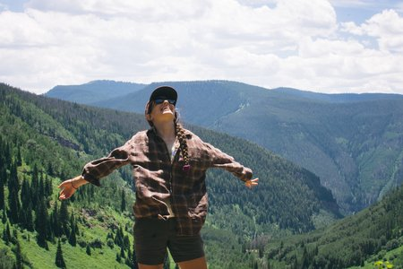 girl smile happy colorado travel mountains hiking trees