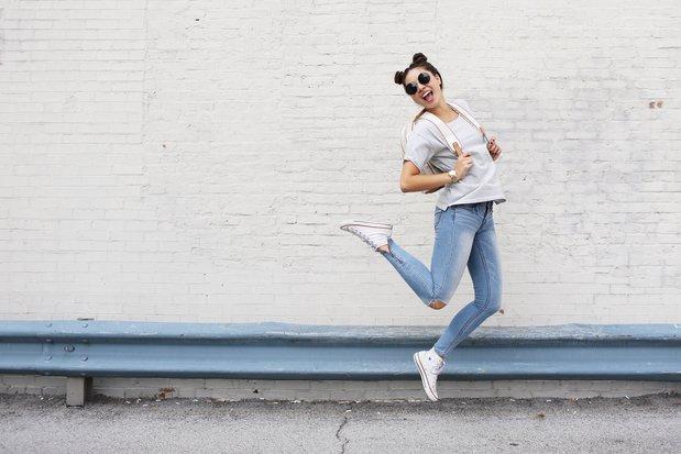 girl sunglasses jumping backback converse happy