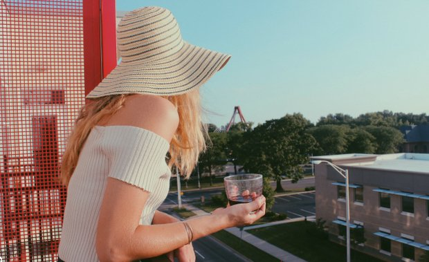 Anna Schultz-Girl In Sunhat With Wine Glass On Balcony