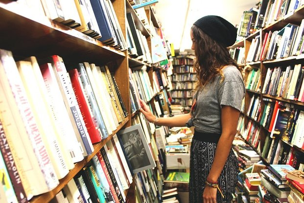 The Lalagirl Looking Through Books