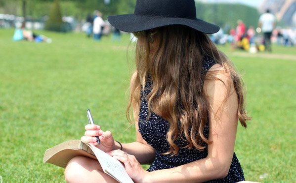 Kellyn Simpkin-Hat Girl Writing Book Grass Outside