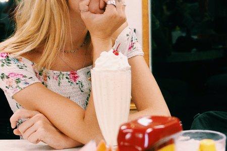 Anna Schultz-Girl Sitting At Diner With Milkshake Pondering