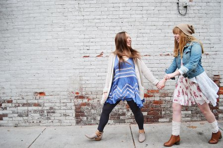Firends Holding Hands And White Brick Wall 2