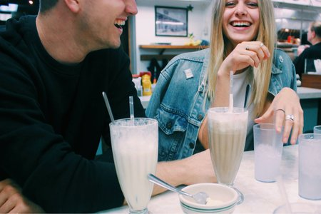 Anna Schultz-Girl And Guy Couple Laughing With Milkshakes