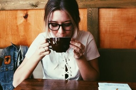 Amelia Kramer-Girl Wearing Glasses Sipping Coffee