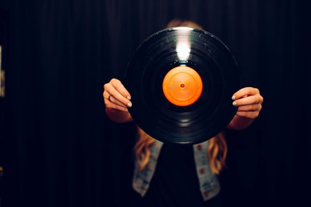 Girl Holding Vinyl Record