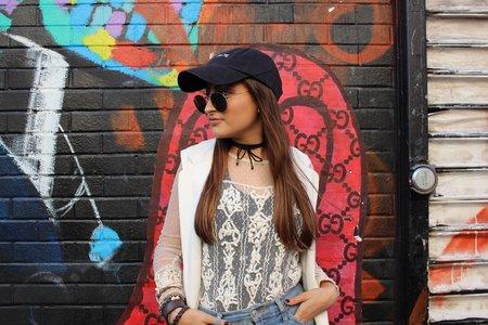 Girl In Baseball Cap Against Mural Ootd 2