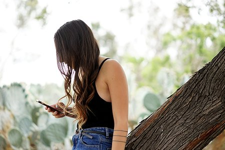 Kellyn Simpkin-Girl Scrolling Phone High Waisted Jeans Watch Curly Hair Cactus
