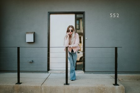 Girl In Front Of Apartment