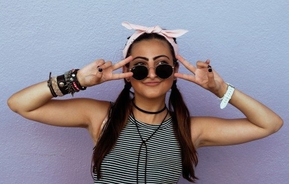 Girl With Pigtails Peace Sign Front