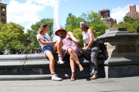 The Lalathree Girls Sitting By A Fountain