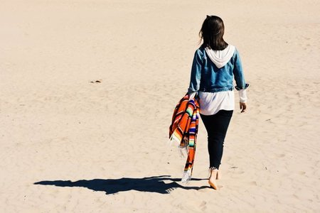 Girl At The Beach Walking With Blanket