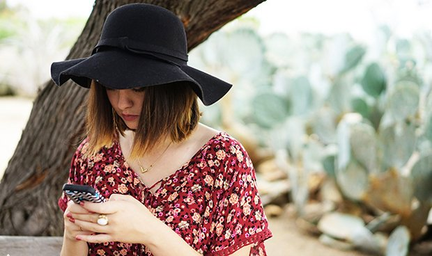 Kellyn Simpkin-Texting Hat Girl Cactus Bench Floral Shirt
