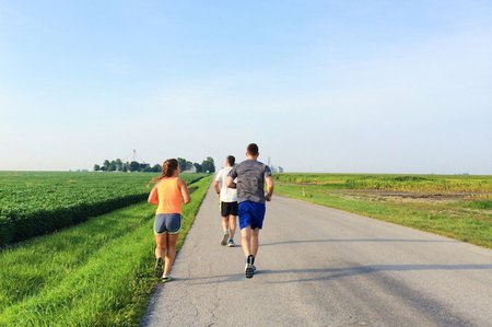 Three People Running In The Countryside
