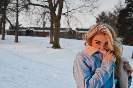 Girl In Snow With Jean Jacket