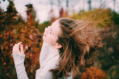Girl With Hair Blowing In The Wind Fall