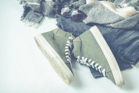 Green High Top Sneakers Beside Bottoms And Sunglasses