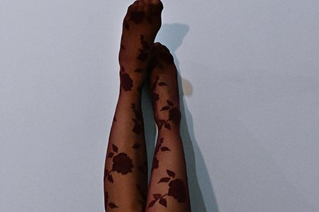Photo Of Woman Wearing Floral Stockings