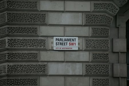 gray building with white Parliament Street signage photo