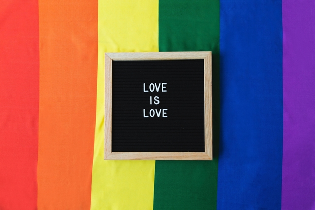 Love is Love board on Pride Flag