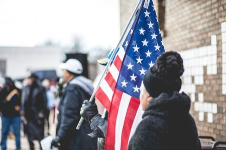 Black woman with american flag