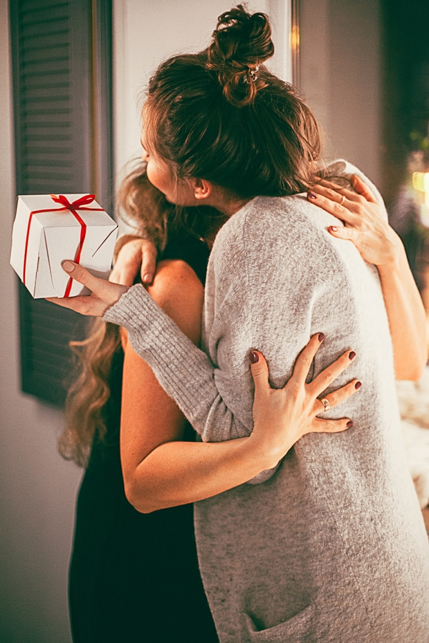 two women hugging with gift