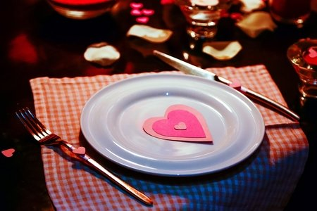 Plate with Valentine's Day decorations on it, on a nice table