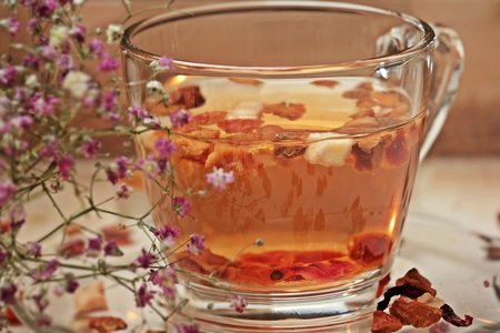 Breakfast tea with flowers and strawberries