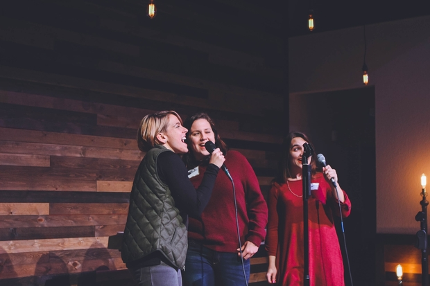 Three girls singing