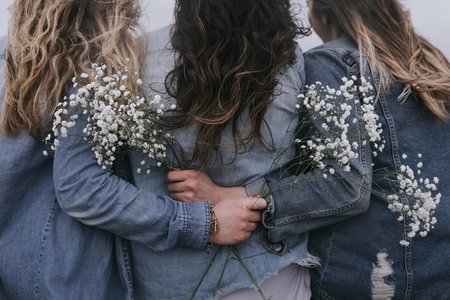 Women in jean jackets with flowers