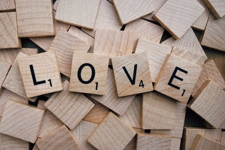 LOVE spelled out with scrabble letter tiles