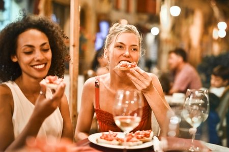 Women eating bruschetta together