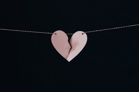 broken heart on a string with black background
