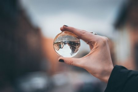 glass orb and city
