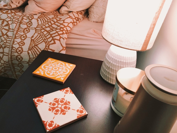 decorated night stand with lamp and tiles