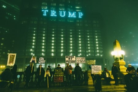 protestors at night outside of trump tower