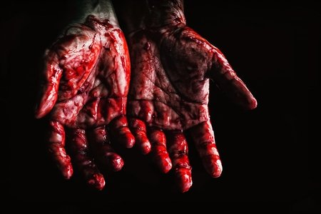 """A woman's hands palm-up covered in """"blood"""""""