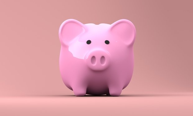 Pink piggy bank with pink background