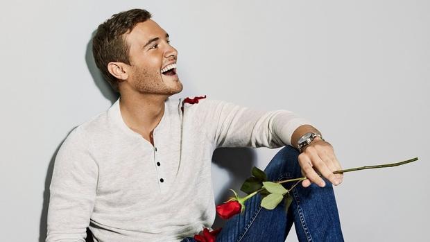 man sitting with rose
