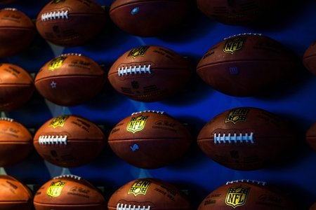 Rows of footballs on a wall
