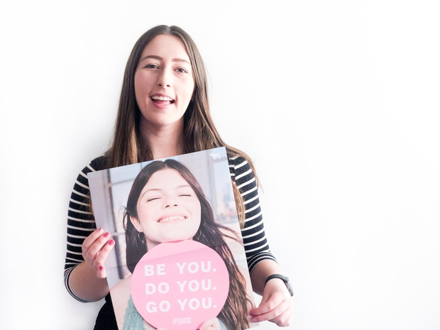 Photo of Kim Davison holding PINK GRL PWR poster to be used in an interview article